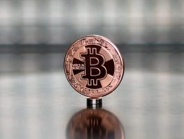 Bitcoin (BTC) copper commemorative coin in protective acrylic case